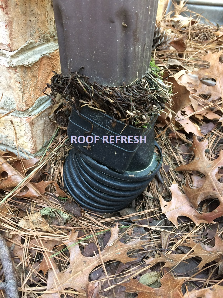 Clogged gutter pipes underground - Roof Refresh